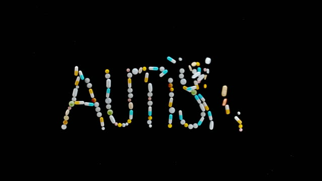 "slo mo ld ""autism"" inscription made out of colourful tablets, pills and capsules flying off the black surface - capital letter stock videos & royalty-free footage"