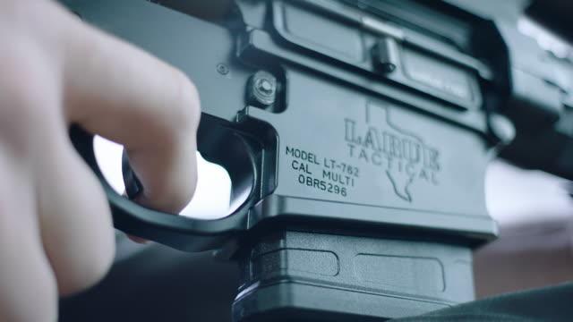 insert male hand pulls trigger on machine gun - machine gun stock videos & royalty-free footage