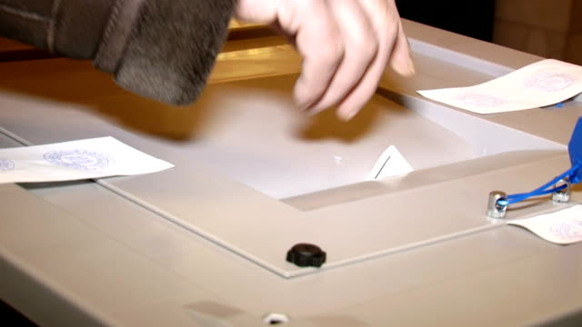 stockvideo's en b-roll-footage met insert the elected ballot - stembus