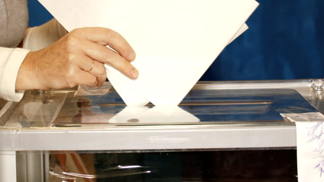 insert the elected ballot - voting ballot stock videos and b-roll footage
