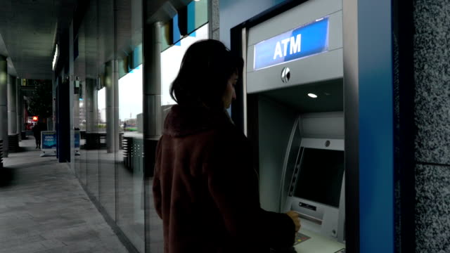 ATM inserting card entering password