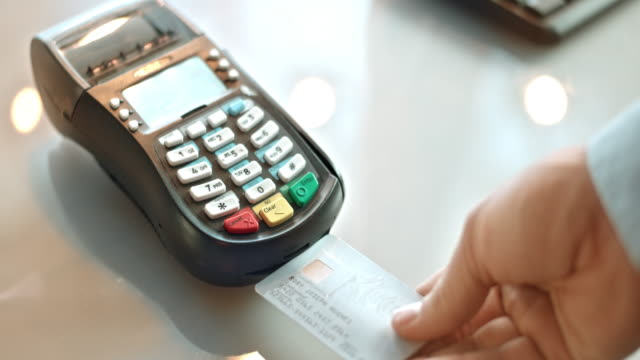 slo mo inserting credit card and typing the code - credit card stock videos and b-roll footage