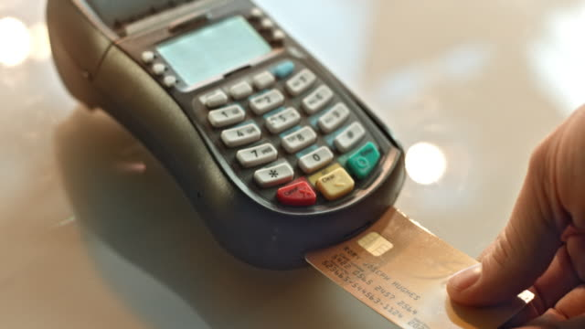 SLO MO PAN inserting credit card and typing the code