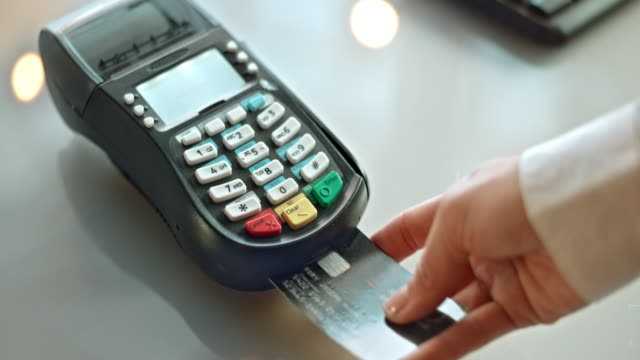 slo mo inserting the credit card and typing the amount - credit card purchase stock videos & royalty-free footage