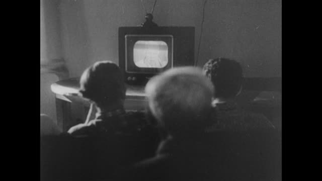 vídeos de stock e filmes b-roll de inside a communications tower and people watching television in berlin - 1958