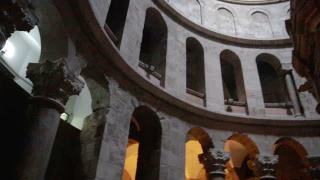 inside a grave jesus christ jerusalem, israel  - stock video - resurrection religion stock videos & royalty-free footage