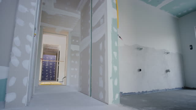 inside a house after the drywall phase of construction - renovation stock videos & royalty-free footage