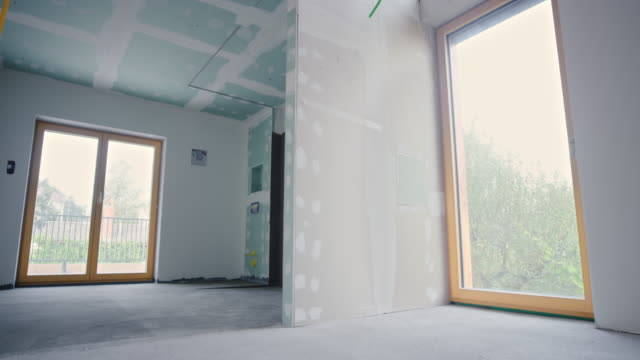 inside a house with installed plaster walls - renovation stock videos & royalty-free footage