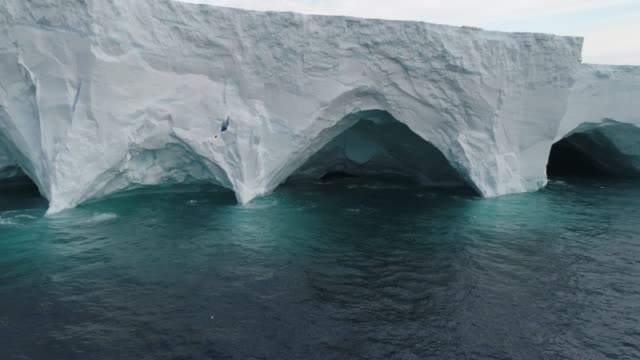inside a massive tabular iceberg - antarctica drone stock videos & royalty-free footage