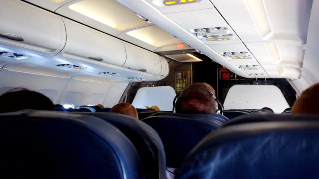 inside a passenger plane - narrow stock videos & royalty-free footage