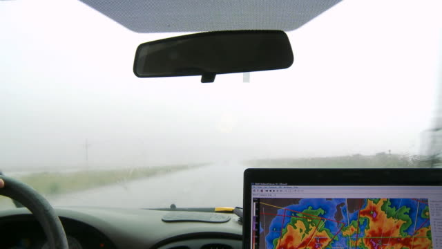 inside a storm chaser's van on a rainy road, close view of weather map with hot spots - artbeats stock videos & royalty-free footage