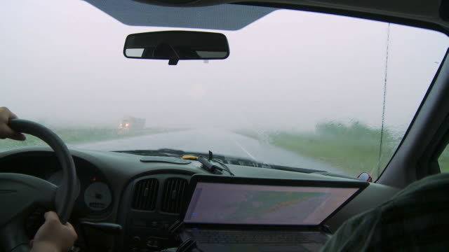 Inside a storm chaser's van on a rainy road
