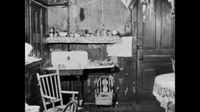 / Inside a very run down apartment / peeling paint and bare necessities Poor housing conditions on January 01 1960