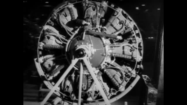 vídeos de stock e filmes b-roll de inside airplane engine factory / several men holding an engine / donald douglas talks about charles lawrance and air cooled engine development /... - general electric