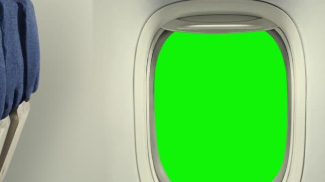 vídeos de stock e filmes b-roll de inside airplane zooming out the window - fundo verde