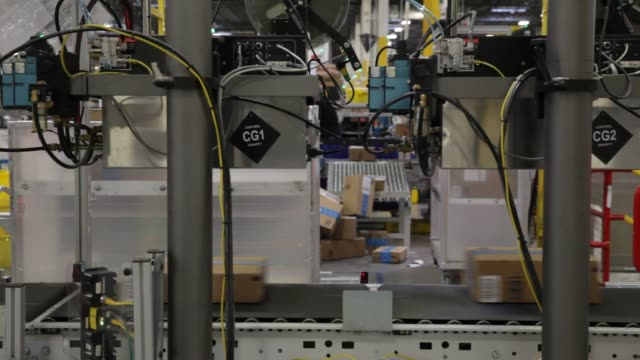 Inside an Amazoncom Inc fulfillment center on Cyber Monday in Robbinsville New Jersey US on Monday Nov 28 2016 Shots employee grabs yellow bin and...