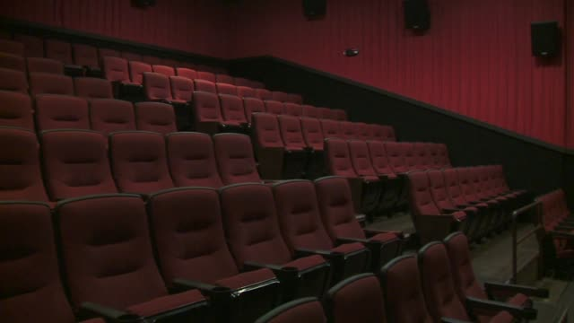 inside an empty movie theater, including exit sign and projector, at north star cinemas in michigan on august 6, 2015. - 席点の映像素材/bロール