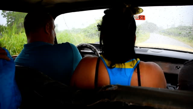 Inside an old American car used as a taxi between Pinar del Rio city and the Vinales Valley / The car has no wipers now glass in the windows and no...