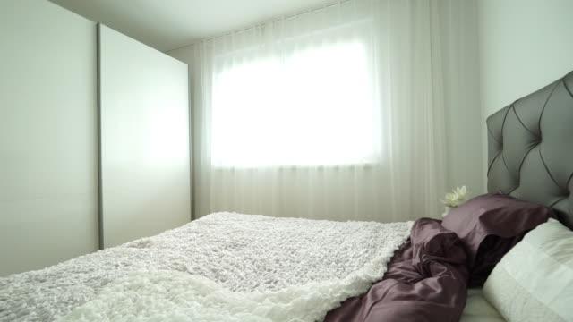 stockvideo's en b-roll-footage met inside bedroom - dubbel bed