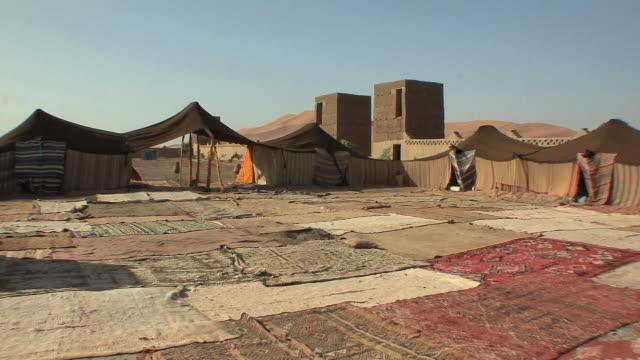 ws pan inside berber campsite at edge of sahara, merzouga, morocco - craft stock videos & royalty-free footage