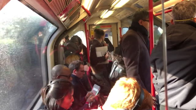 inside busy trains in london as people are unable to adhere to social distancing during coronavirus pandemic - busy stock videos & royalty-free footage