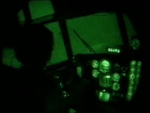 stockvideo's en b-roll-footage met inside cockpit as pilot flies plane over iraq at night during iraq war; 01 apr 03 - pilot