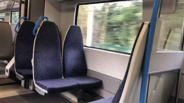 inside empty thameslink train as people are told to stay at home during the coronavirus pandemic - stay at home order stock videos & royalty-free footage