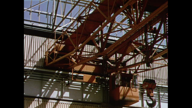 stockvideo's en b-roll-footage met montage inside factory producing heavy electrical machinery in bhopal / india - bhopal