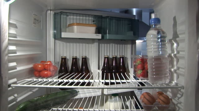 inside fridge - man gets a beer hd & pal - refrigerator stock videos and b-roll footage