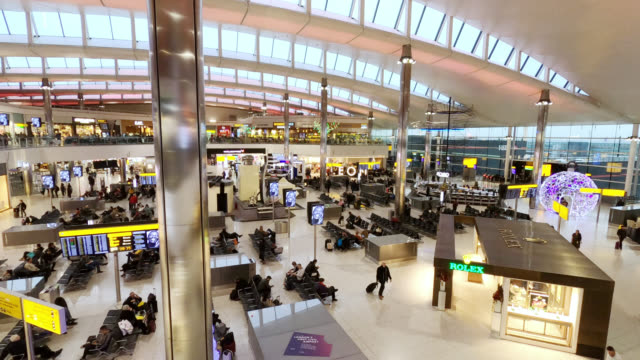 inside heathrow terminal 2 the queen's terminal - passenger stock videos & royalty-free footage