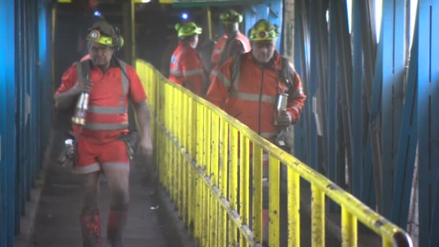 Inside mins workers complete final shift at Kellingley Colliery ENGLAND North Yorkshire Beal Kellingley PHOTOGRAPHY** Coal miners walking down...