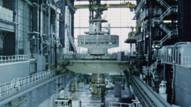 1983 td inside nuclear power plant under construction, with core reactor and steam generators / united kingdom - atomkraftwerk stock-videos und b-roll-filmmaterial