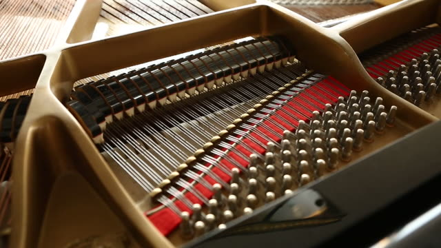 inside of a classical piano as it is being played - musical instrument string stock videos & royalty-free footage