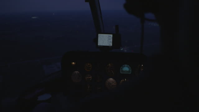 inside of a helicopter, city, night, helicopter pilot