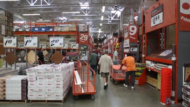 BROLL inside of a Home Depot location in Torrance California Customers push shopping carts down various aisles inside a Home Depot Employees help...