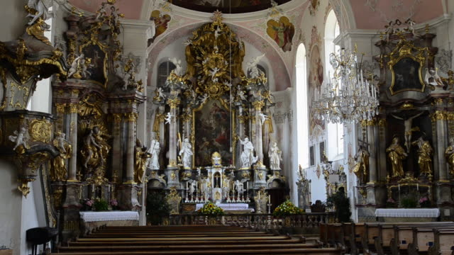 ms inside of baroque church in historical old town / oberammergau, bavaria, germany - altare video stock e b–roll
