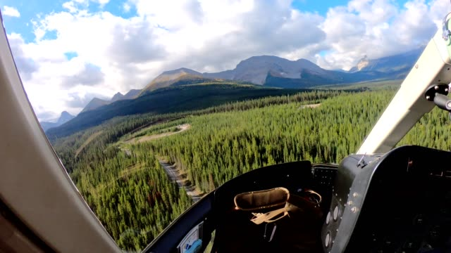 inside of helicopter flying on canadian rockies in assiniboine provincial park - helicopter landing stock videos & royalty-free footage