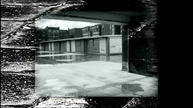 holistic approach to social housing design england london ext rain falling on paving slabs zoom in to graphcised b/w sequence showing 1960s and 1970s... - television show stock videos & royalty-free footage