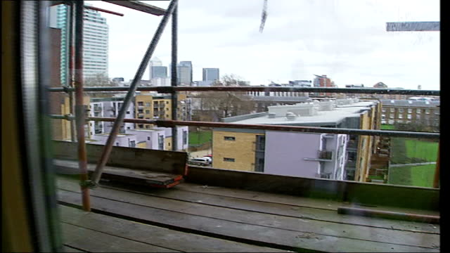 holistic approach to social housing design int reporter towards with architect andy heath interview sot talks about design considerations and tenant... - tenant stock videos & royalty-free footage