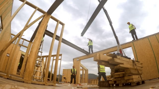 time-lapse inside rooms of the prefab wooden home being put up along with the first floor - construction material stock videos & royalty-free footage
