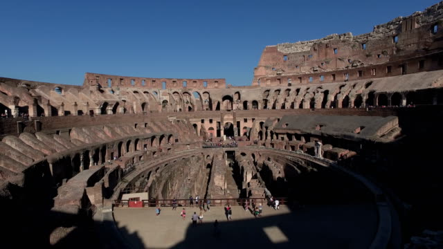 4k: inside the colosseum in rome, italy - pan up - colosseum rome stock videos and b-roll footage