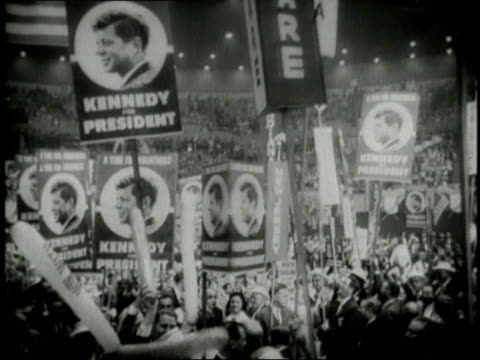 inside the democratic convention with crowds of cheering delegates waving signs of states and for jfk and lbj / los angeles, california, united states - john f. kennedy us president stock videos & royalty-free footage