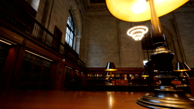 inside the new york central library - bookshelf stock videos & royalty-free footage