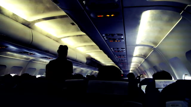 inside the passenger compartment in an airliner - crew stock videos & royalty-free footage