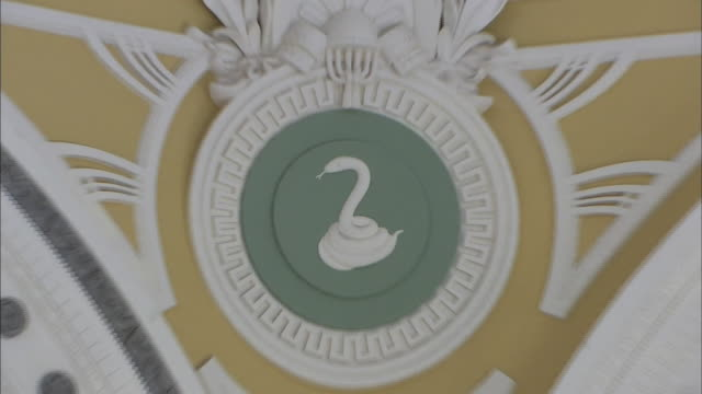 inside the restored tokyo station marunouchi building zooming in on the zodiac relief on the wall inside the dome - begriffssymbol stock-videos und b-roll-filmmaterial