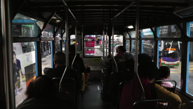 inside the tram running through the city / hong kong - street name sign stock videos & royalty-free footage