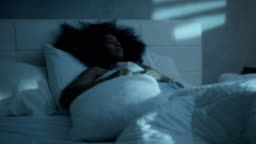 Insomnia For Young Black Woman Sleeping In Bed At Home