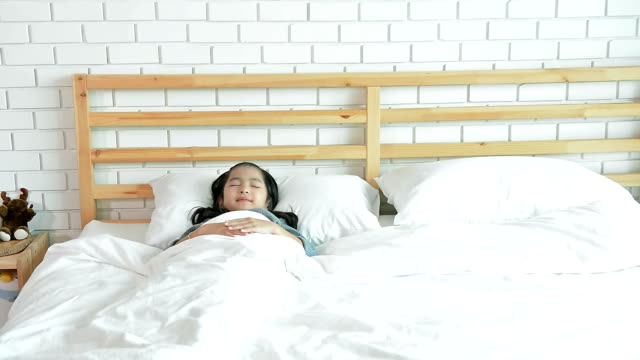Insomnia Sleepless, Young Daughter Suffering From Nightmare And Moving Body On The Bed