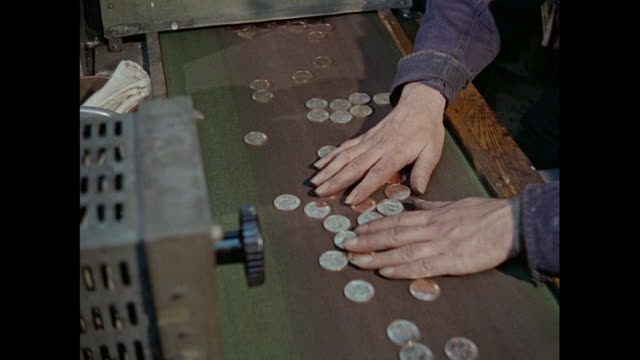 montage inspection of coins produced for the royal mint in london / united kingdom - royal mint stock videos & royalty-free footage
