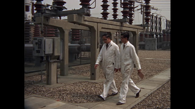 montage inspection of electrical station and power lines in united kingdom - generator stock videos and b-roll footage
